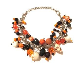 Halloween Skull Bracelet. Black and Orange with White Skulls.