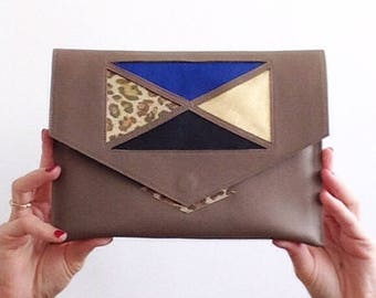 Taupe and graphic pattern cobalt-gold-black-leopard clutch iridescent magnetic closure