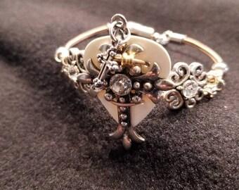 BLING cross re-purposed guitar string bracelet! BEAUTIFUL!!!