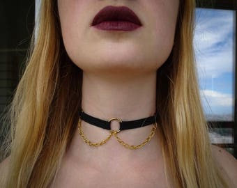 black choker with a golden chain