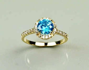 14k solid yellow gold 1.15 carat natural Blue Topaz nice wedding ring 2.5 grams, size 7