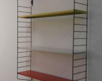 wall rack by Tomado, designer d. Davis