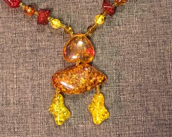 Faux amber confetti/glitter lucite tribal look necklace
