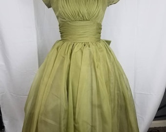 Be the Belle of Ball in this peridot green tulle dress.