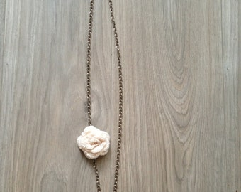 Necklace with crochet flower.
