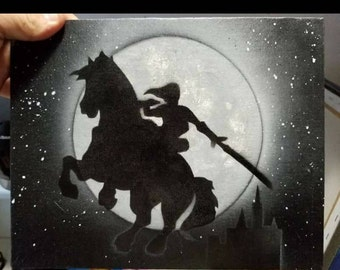 Link from Zelda riding a horse in the moonlight
