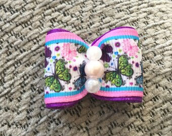 Purple butterfly print dog bow