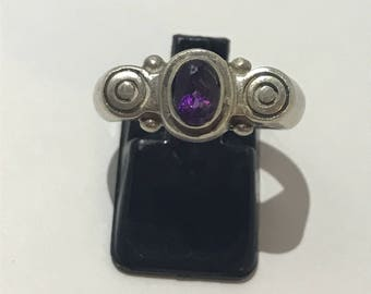 925 sterling silver ring and a small central Amethyst size 56 French