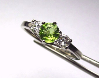 Enchanting Peridot Round in an Accented Sterling Silver Ring