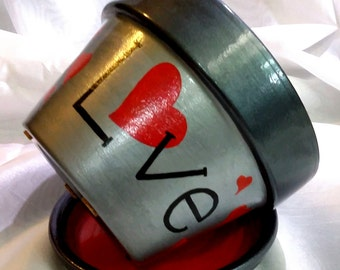 Love/Amor.  The word love was hand painted in English on one side and in Spanish on the other.  A great conversation piece at home or work