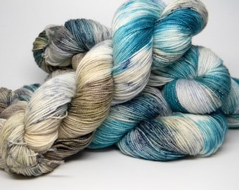 My Summer Romance on Disco Monkey Merino nylon stellina blend fingering weight hand painted sock yarn olive teal navy speckles with metallic