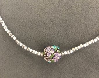 Silver necklace with beautiful glass flower bead
