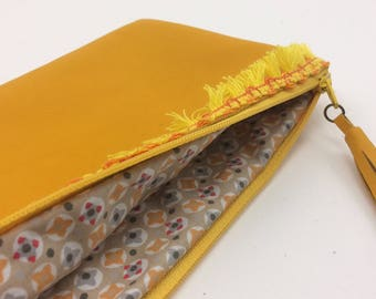 Yellow color leather clutch. With Zip and leather tassel.