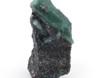 Raw emerald stone of 58 grams with matrix of black mica and quartz.