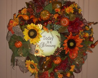 """Fall Time Wreath,Featuring Yellow and Orange sunflowers, Pumpkins and squash, Beautiful sign stating """"Today is a Blessing, Wonderful daisies"""