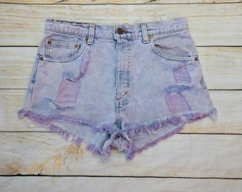 Vintage Levi's 550 jeans converted into distressed purple wash high waist cut off shorts