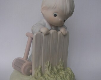 """Precious Moments """"It May Be Greener But It's Just as Hard to Cut"""" Porcelain Figurine - Enesco - Vintage Collectible - Retired - Original Box"""