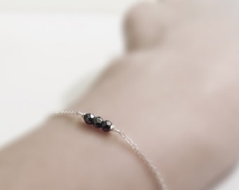 Shiny charcoal (bracelet) - Three tiny Hematite nuggets on dainty sterling silver chain