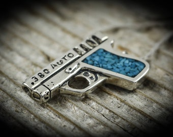 Sterling silver Automatic .380 auto gun pendant with crushed Kingman Turquoise