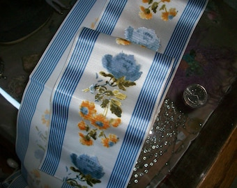 1 yd. Cut velvet ribbon with blue roses and golden yellow flowers