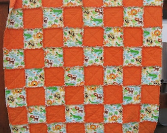 Orange and White Jungle Themed Crib sized Flannel Rag Quilt with Lions and Tigers