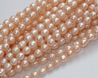 16 in strand of cultured freshwater rice pearls peach 7-8mm