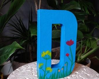 Hand painted blue botanical design letter