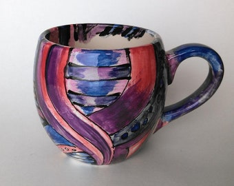 Hand painted small spherical mug in purples, blues and pinks