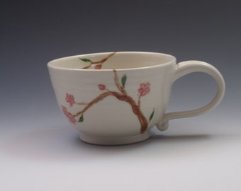 Porcelain tea cup with cherry blossoms, handthrown and handpainted cup
