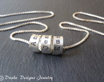Hand stamped mothers day jewelry with kids names. sterling silver mom necklace