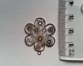 "Silver metal charm ""flowery round"" watermark"