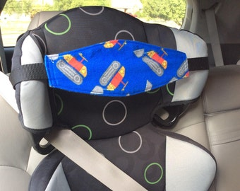 Child car seat Nap Strap, with adjustable strap.  Bulldozers