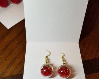 Red dangle bulb earrings