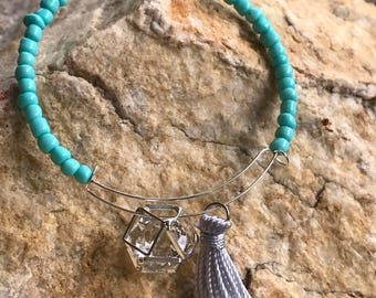 Teal seed bead memory wire bracelet with tassel and charm