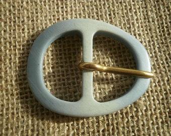 Oval belt buckle made of plastic, blue color, size 5.5 / 4.2 cm