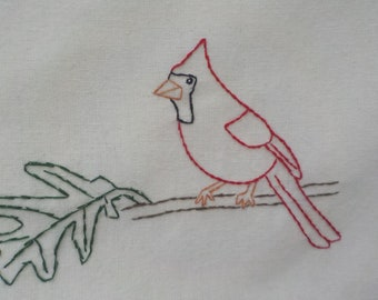Cardinal on white oak tea towel-hand embroidered