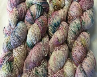 Hand dyed fiber. 70/30% Superwash Merino and Silk.  Colorway is Jaw Breaker.  Colors are the many layers of this candy.