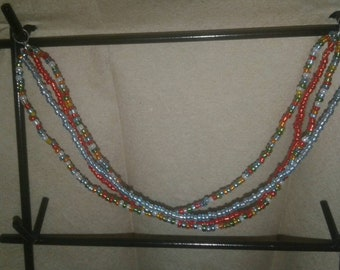 Four Strand Seed Bead Bracelet with Mix of Colors.
