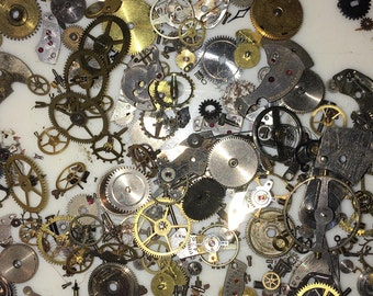 10 Grams All Steampunk watch gears and parts  , For art , jewelery making etc . All parts ultrasonic cleaned and are removed by  Watch Maker