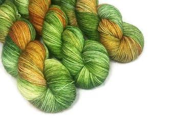 Hand Dyed Yarn 'Olive Juice' - Sock Weight Tonal Speckled Yarn - 463yd/100g of 75/25 Merino/Nylon Superwash Yellow Green and Purple Yarn