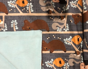 Wildlife and blue flannel tuck behind bundle up blanket