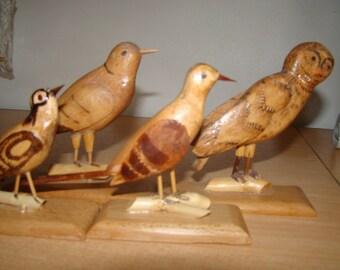 Set of wooden bird sculptures handmade