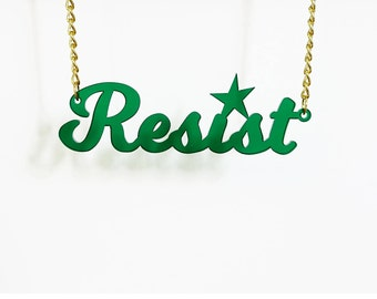 RESIST necklace in transparent dark emerald for nasty women, resisters and persisters.