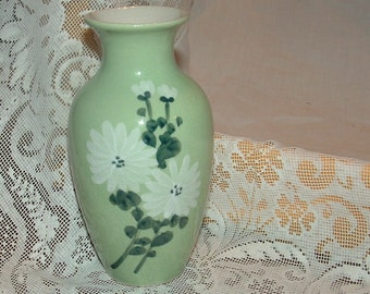 Elegant Petite Green Porcelain Vase with White Flowers and Dark Green Leaves