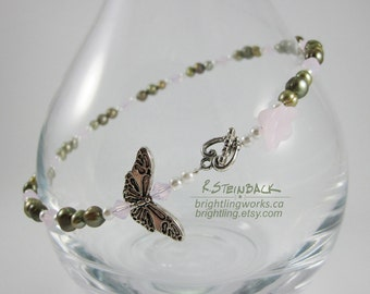 Petals & Wings; Light and Lovely Versatile Necklace With a Toggle Clasp, Silver Butterfly Charm, Green Freshwater Pearls and Soft Baby Pinks
