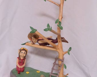 Pixie loving couple on natural wood branch