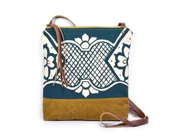 weekdayer • crossbody bag - waxed canvas • geometric floral print - brown waxed canvas • cross body bag • mustard - teal - red orange