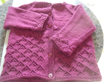 "Girl's lacy cardigan to fit up to a 24"" chest."