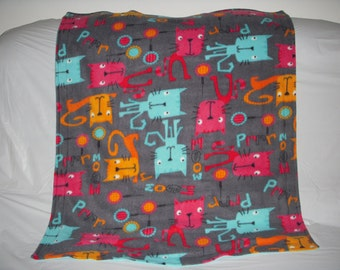 Kitty Blanket - colorful skinny kitties on gray with a solid mint green fleece on the reverse side