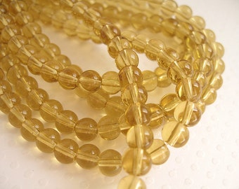 50 beads in transparent yellow glass straw 6mm